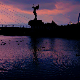 Head In The Clouds by Vince Scaglione - Buildings & Architecture Statues & Monuments ( clouds, water, reflection, ducks, indian, native american, statue, native, ripples, monument, bridge, head, river )