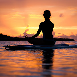 Enjoying the Peace by Troy Wheatley - Sports & Fitness Other Sports ( water, orange, woman, sunset, paddleboard, yoga, , colorful, mood factory, vibrant, happiness, January, moods, emotions, inspiration, relax, tranquil, relaxing, tranquility )