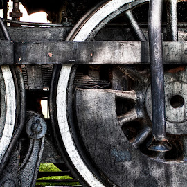 Iron Wheels by Lawrence Burry - Transportation Trains ( abstract, vintage, railroad, texture, wyoming, wheels, rusty, steel, leaf springs, steel rods, rail, train, union pacific, laramie )