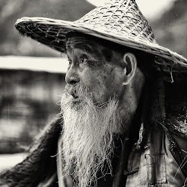 Yangshuo oldest fisherman by Dharmali Kusumadi - People Portraits of Men (  )