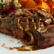 Rib-Eye Steaks with Mushrooms, Brandy and Blue Cheese