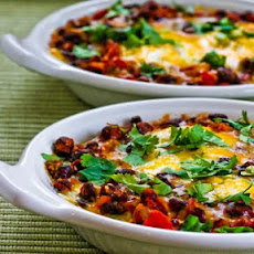 Mexican Baked Eggs with Black Beans, Tomatoes, Green Chiles, and Cilantro