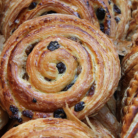 Danish pastry at Borough Market, London England by Judith Dueck - Food & Drink Cooking & Baking ( tea time, appetizing, breakfast, icing, french, rolls, baked, rolled up, bakery, bread, raisins, yeast, calories, gluten, closeup, dessert, wheat, glazed, buns, fattening, crisp, refreshment, yummy, delicious, snack, soft, tasty, sweet, food, coiled, danish, pastry, treat, sugar )