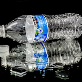 Quench Your Thirst by Tiffany O'Malley - Food & Drink Alcohol & Drinks ( water, open, recycle, for sale, plastic, product photography, thirsty, h2o, spilled, bottle )