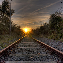 There's light at the and of the track by Marcel de Groot - Transportation Railway Tracks ( orange, railway, sundown, track, forest, light,  )