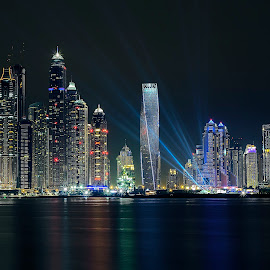 Dream city by Arshad P Hamza - City,  Street & Park  Night ( canon, water, building, yellow, city, red, blue, sigma, dubai, shadow, stars, uae, night, light )