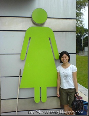She with toilet sign