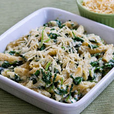 Penne Pasta with Wilted Arugula, Basil, Ricotta, and Parmesan Sauce