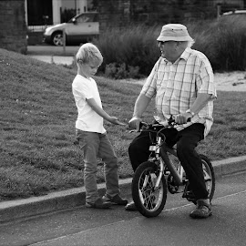 Young Offenders by John Hawthorne - City,  Street & Park  Street Scenes ( cyclist, bike, grandad, young, boy,  )