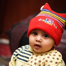 The Amused Baby  by Ammar Ahmed - Babies & Children Toddlers ( #babiesandchildren, #baby, #portrait, #candid, #cute, #colours, #photography )
