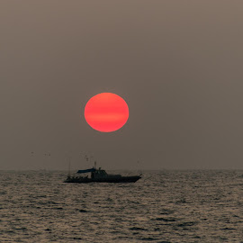 sunset by Azad Nechikkade - Landscapes Sunsets & Sunrises ( red, day over, sea, night, suset, boat, sun )