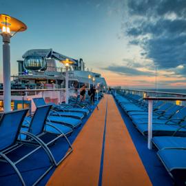 Cruiseship by Joseph Law - Transportation Other ( lightning, cruiseship, blue sky, chairs, morning glory, deck, running trail )