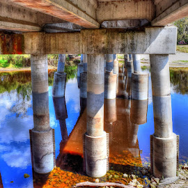 Pillar Paradise by Mark Ayers-Stebenne - Buildings & Architecture Bridges & Suspended Structures ( clouds, sky, reflections, bridge, waterway, pillars,  )