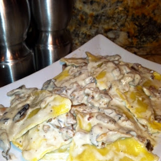 Ravioli with Garlic Cream and Mushroom Sauce