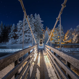 Frost-covered bridge in moonlight by Petri Puurunen - Landscapes Travel