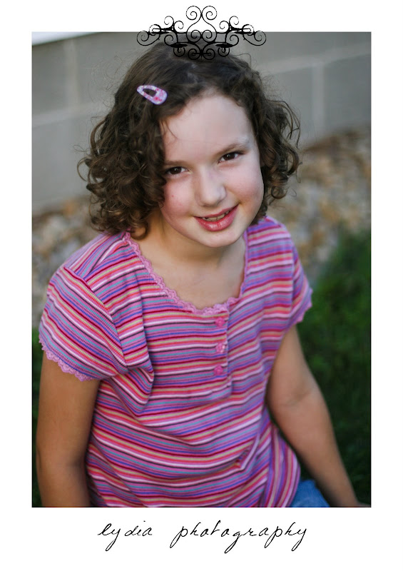Little girl with a pink clip at lifestyle kids portraits on a farm in Indiana, Pennsylvania