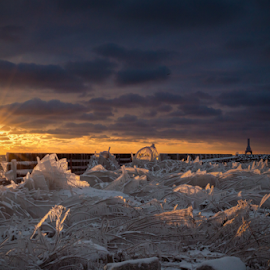 Fire and Ice by James Meyer - Landscapes Sunsets & Sunrises ( clouds, ice, sunset, dramatic, lighthouse, sunrise, frozen, fire,  )