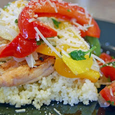 Chicken Smothered with Summer Vegetables on a Bed of Couscous