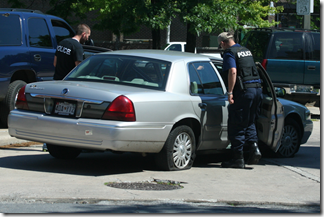 Police looking at the suspect's car