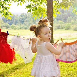 Caught in my Petticoat by Cheryl Korotky - Babies & Children Children Candids ( getting caught in undergarments, a heartbeat in time photography, fun picture ideas, child model nevaeh, petticoat, laundry )