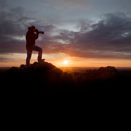 Photographer At Sunrise by Chris Paul - People Portraits of Men ( cool, clouds, warm, sky, shadow, silhouette, sunset, photographer, sunrise, morning )