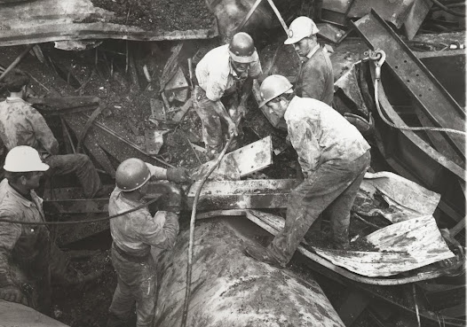 Rescuers search through the rubble (detail)