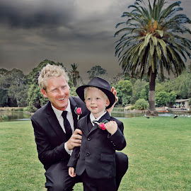 Hat On! by Alan Evans - Wedding Getting Ready ( page boy, wedding photography, melbourne wedding photographer, park, melbourne, grass, aj photography, getting ready, landscape, palm tree, melbourne botanic garden, wedding, botanic garden, trees, groom, garden )