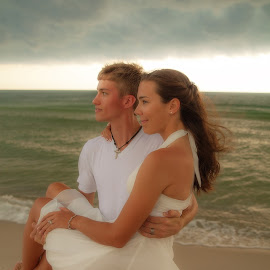 Facing the storm by Shelley Patterson - People Couples ( water, wedding, couple, beach, storm, bride, groom )