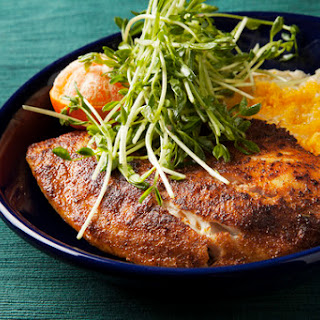 Blackened Tilapia with Cheddar Grits & Pea Shoots