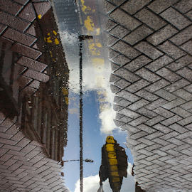 puddle man by Tim Woolf - City,  Street & Park  Street Scenes ( street, reflections, wet, puddle, kingston,  )