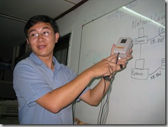 Mr. Vanra Ieng shows a nift enclosure that makes sure the phone plugged in to the computer will be reliably working!