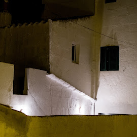 Es Mercadal by Joan Vega - Buildings & Architecture Homes ( old, old town, windows, architecture, menorca, es mercadal, lights, dark, night, town, darkness, construction, wall )