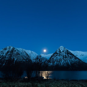 Blue sky over hills by Benny Høynes - Landscapes Mountains & Hills ( hills, moon, blue, boathouse, norway )