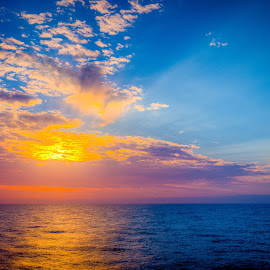 Dawn at Sea by Brent McKee - Landscapes Sunsets & Sunrises ( clouds, colors, ocean, sunrise, morning )