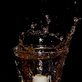 Splash Photography attempt.. by Santosh Mulik - Artistic Objects Cups, Plates & Utensils ( splash photography photo tag water night candle light glass creative canon india pune )