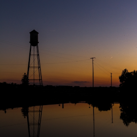 The Old Water Tower by Kriss Haren - Buildings & Architecture Other Exteriors ( water, reflection, 2014, haren images, landscape, water tower, lima, rural, sky, nature, sunset, outdoor, fall, kriss haren, pond )