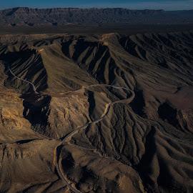 Desert by Tom Shope - Landscapes Deserts ( wilderness, mountains, desert, dirt road, road )
