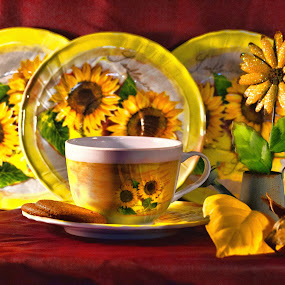 Sunflower Supper by Carole Pallier  - Artistic Objects Still Life ( sunflowers tea plates cups biscuits leaves, red, green )