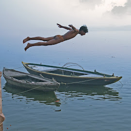 Flying man by Mahul Mukherjee - People Street & Candids ( ganges, boat, photo, man, river, jump )