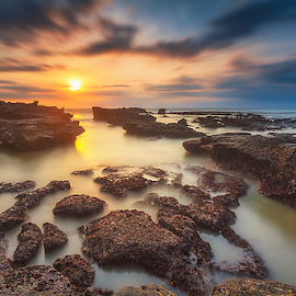 Tranquility by Rio Tanusudiro - Landscapes Beaches ( coral, waterscape, sunset, long exposure, rock, skylight, seascape, beach, motion, sunlight, light )