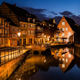 Colmar City By Night by Lillian Molstad Andresen - Buildings & Architecture Architectural Detail ( doors, clouds, lightpoles, streetlight, colmar city, street, reflections, windows, cityscape, alcase province, water-canal, city, fence, sky, petit venise, stars, halftimbered houses, trees, night, france, river )