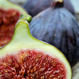 Fresh figs by Heather Aplin - Food & Drink Fruits & Vegetables ( fruit, fresh, half, slice, seeds, luscious, cut, figs )