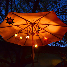 Evening Lights by Kathleen Koehlmoos - Novices Only Objects & Still Life ( beautiful light, gorgeous umbrella, back garden, back-yard whimsy, artistic light, tea lights,  )