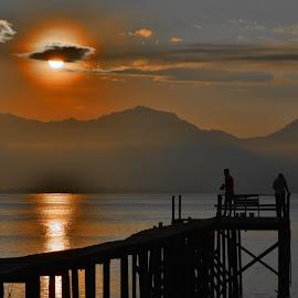 Fishing in the silence morning by Arief Adi - Landscapes Sunsets & Sunrises ( water, banyuwangi, sea, jetty, seascape, sunrise, fishing, nikon, landscape, morning, sun )