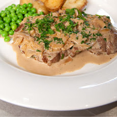 Steak Diane with sauteed potatoes and peas
