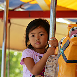 Merry go round n round by Melissa Marts Faust - City,  Street & Park  Amusement Parks ( merry go round, girl, amusement park, horse, carousel )