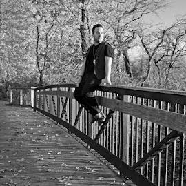Moritz by Joshua Moritz - People Portraits of Men ( railing, photograph, male, white, bw, portrait, sitting, bridge, handsome, man, black, vest, gentleman )