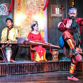 The Artist of Hoi An by Stephen Bridger - People Musicians & Entertainers ( music, hoi an, tradition, vietnamese, performer, southeast asia, traditional, vietnam, travel, dance, travel photography )
