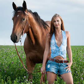 In the field by Martin Zenisek - Animals Horses ( field, girl, color, horse, jeans, portrait )