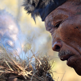 Portrait of a Bushman in Namibia by Jaclyn T - People Portraits of Men ( tribe, primal, bushmen, africa, fire, namibia )